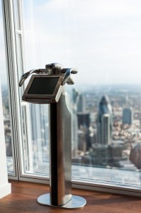 A high-tech Tell:scope which displays live and recorded scenes and descriptions on a digital screen