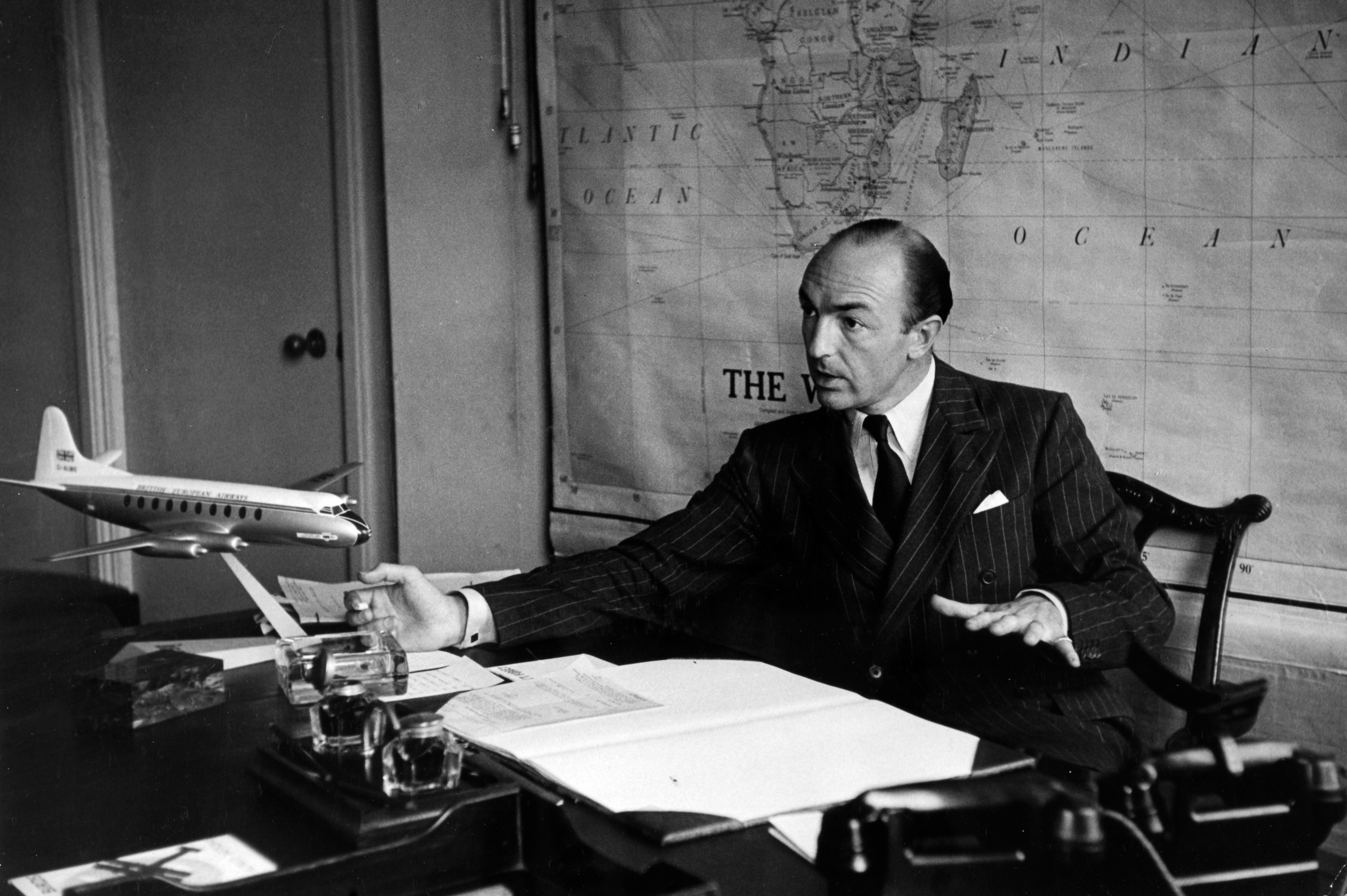 Profumo, the ambitious minister aged only 38, at his desk at the Ministry of Aviation in 1953. (© Popperfoto/Getty Images.)