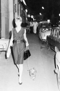 The actress Audrey Hepburn walking her dog in a Rome street in 1961.