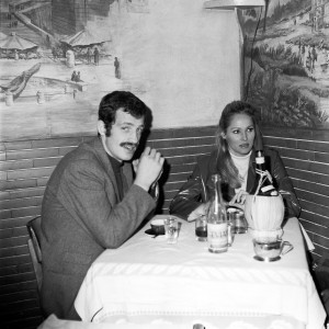 The actors Jean-Paul Belmondo and Ursula Andress eating in a Rome restaurant in 1965 having worked on the film Up to His Ears.