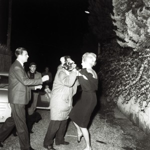 Swedish actress Anita Ekberg, star of La Dolce Vita, attacks a photographer outside her house in Rome, 20 October, 1960.